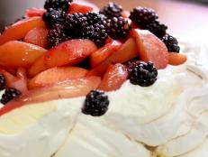 Cooking Channel serves up this Spiced Blackberry, Quince and Apple Pavlova recipe from Lorraine Pascale plus many other recipes at CookingChannelTV.com