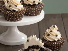 Cooking Channel serves up this Cookie Dough-Stuffed Dark Chocolate Cupcakes recipe  plus many other recipes at CookingChannelTV.com