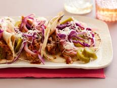 Cooking Channel serves up this Braised Pork Tacos recipe from Rachael Ray plus many other recipes at CookingChannelTV.com