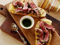 Cooking Channel serves up this Mini Open Faced Steak Sandwiches on Garlic Bread with Aged Provolone and Parsley Oil recipe from Bobby Flay plus many other recipes at CookingChannelTV.com