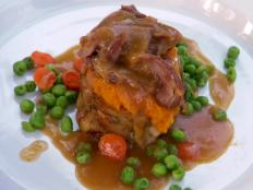 Cooking Channel serves up this Hot Turkey Dinner: Heritage Turkey Leg Confit with Maple Whipped Sweet Potatoes, Baby Carrots and Sweet Peas recipe from Lynn Crawford plus many other recipes at CookingChannelTV.com