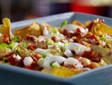 Cooking Channel serves up this Chili Cheese Dog Nachos recipe  plus many other recipes at CookingChannelTV.com