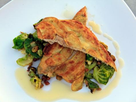 Potato-Crusted Trout Filets with Caramelized Brussels Sprouts, Plump Golden Raisins, and Toasted Pecans