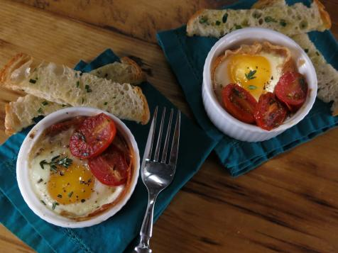 Shirred Eggs with Prosciutto, Candied Tomatoes, Parmesan-Rosemary Cream and Ciabatta Sticks