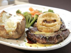 CCKXB101_whiskey-steak-onion-rings-baked-potato-recipe_s4x3